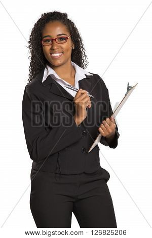 African Young Businesswoman Take Note On Folder