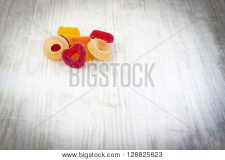 Colorful Jelly Candy On White Wooden Background