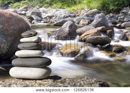 Close Up Of Zen Stones With Background The Garden And The Lake