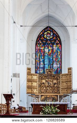 GDANSK, POLAND - AUGUST 20, 2015: Chancel altar and stained glass window in St. Mary's Church (Basilica Mariacka) in Gdansk Poland