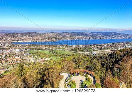 Zurich, Switzerland - 20 April, 2016: view on the city of Zurich and Lake Zurich from Mt. Uetliberg. Mt.Uetliberg is a mountain of the Swiss plateau rising to 869 m it offers a panoramic view on the entire city of Zurich and the Lake Zurich.