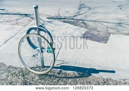 Bike theft with locked wheel in Ottawa Canada (vintage filter)