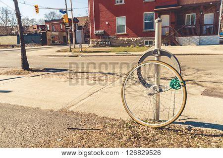 Bike theft with locked wheel in Ottawa Canada (vintage filter)