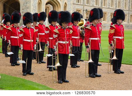 WINDSOR - APRIL 16: Unidentified men members of the royal guard during change ceremony on April 16, 2016 in Windsor, United Kingdom.
