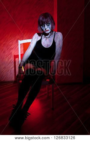 Vampire Girl Posing Sitting On A Red
