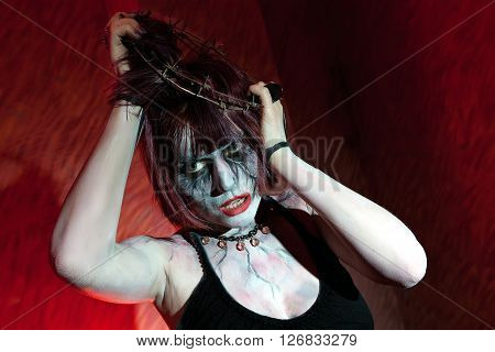 Girl In Stockings With A Crown Of Thorns On Her Head Posing