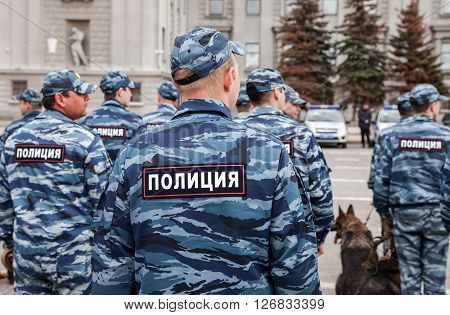SAMARA RUSSIA - APRIL 20 2016: Russian police unit in uniform with police dogs on the Kuibyshev square in spring day. Text in russian: