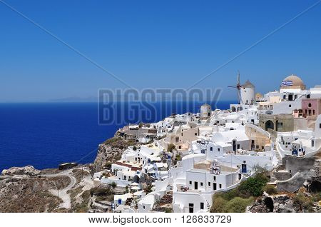 Santorini, one of the Cyclades islands in the Aegean Sea. The white houses of its 2 principal towns, Fira and Oia, cling to cliffs above an underwater caldera. They overlook the clear Aegean sea ...