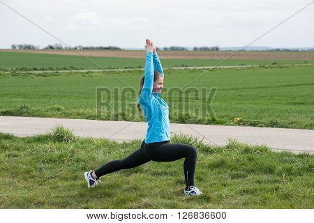 Sport Woman Stetching Outdoors