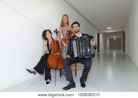 Portrait of three young musicians, interior