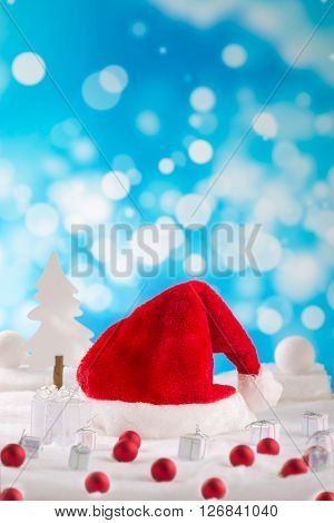 Christmas festive baubles with traditional santa claus hat