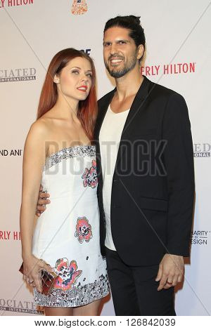 LAS VEGAS - APR 15:  Anna Trebunskaya, Nevin Millan at the  23rd Annual Race To Erase MS Gala at the Beverly Hilton Hotel on April 15, 2016 in Beverly Hills, CA