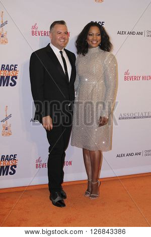 LAS VEGAS - APR 15:  Ross Matthews, Garcelle Beauvais at the  23rd Annual Race To Erase MS Gala at the Beverly Hilton Hotel on April 15, 2016 in Beverly Hills, CA