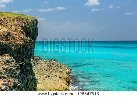 nice great beautiful view of high cliff and tranquil azure ocean against blue sky background on sunny summer day at Varadero island, Cuba