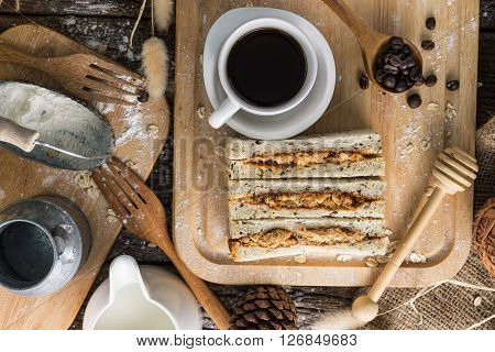 Overhead View Of Coffee Cup And Freshly Baked Bread