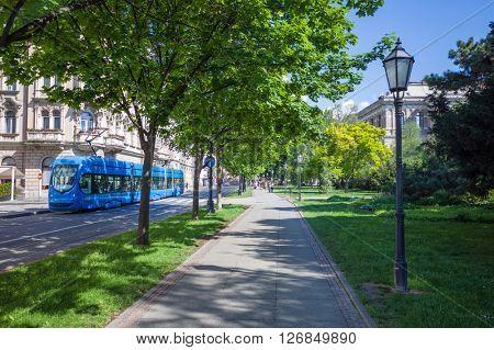 Zagreb, Croatia - green park and blue tramway