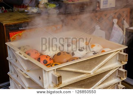 YOKOHAMA JAPAN - NOVEMBER 24 2015: Chinese steamed bun in Yokohama Chinatown, Japan's largest chinatown. A large number of Chinese stores and restaurants can be found in the narrow and colorful streets