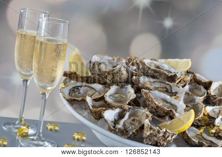 Fresh oysters and champagne for festive dinner party