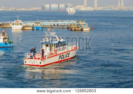 YOKOHAMA JAPAN - NOVEMBER 24 2015: Unidentified Japanese marine police force with watercraft on duty at Yokohama port