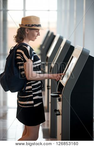 Woman Doing Self-registration For Flight