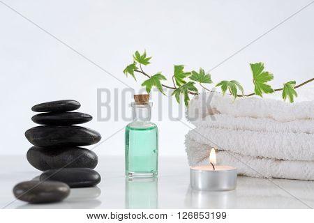 zen basalt stones and cadle, spa background