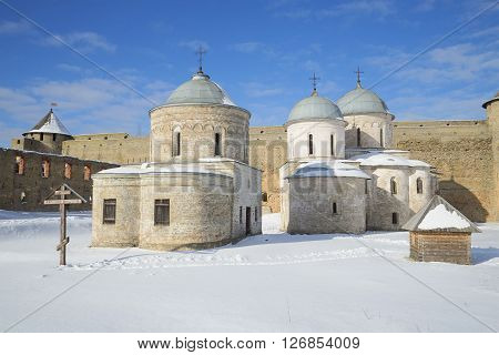 View of the ancient churches of Ivangorod fortress, sunny february day. Ivangorod, Leningrad region, Russia