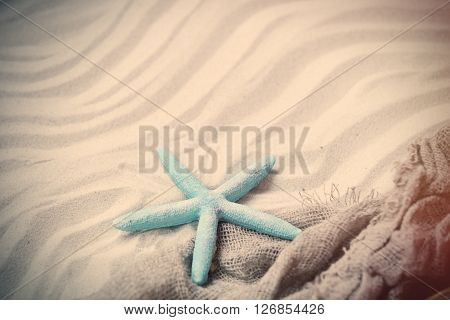 Starfish And Fishnet On The Sand
