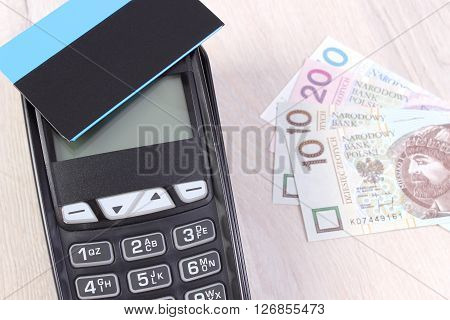 Credit card reader payment terminal with contactless credit card and polish currency money choice between cashless or cash paying for shopping or products