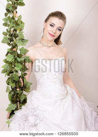 Beautiful bride with fashion wedding hairstyle. Close-up portrait of young gorgeous bride. Wedding.