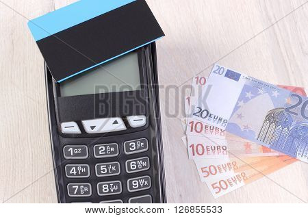 Credit card reader payment terminal with contactless credit card and currencies euro choice between cashless or cash paying for shopping or products