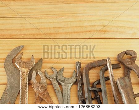 Vintage old rust tool screwdriver wrench drill hex key construction tools on wooden background with copy space at top. Working tools background. Father's day concept.