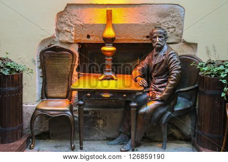 Lviv Ukraine - July 5 2014: Sculpture of Jan Zech near the entrance of pub-museum Gas Lamp. Jan Zech and Ignacy Lukasiewicz invented gas lamp in 1853
