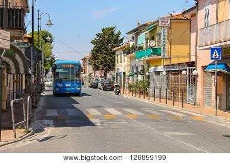 Vada Italy - June 29 2015: Big intercity bus on the street of small town Vada on the coast of the Ligurian Sea. Province Livorno Tuscany region of Italy