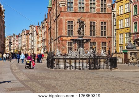 GDANSK, POLAND - APRIL 21, 2016: Street scene with renaissance building and Fountain of Neptune. Old Town in Gdansk is a tourist attraction for visitors.