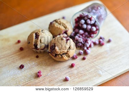 Fresh homemade baked cakes muffins with cowberry