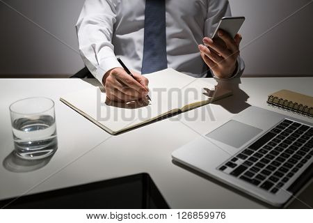Businessman Copying Information