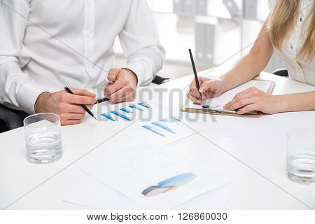 Business people working on business report in office