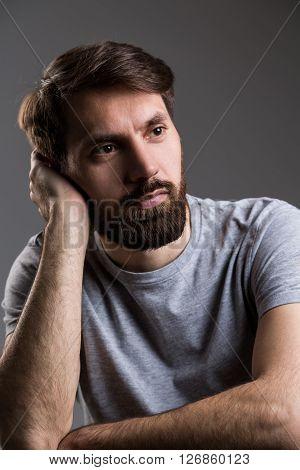 Thoughtful Man Head On Hand