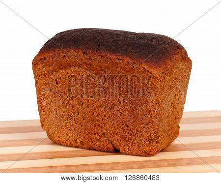 Fresh rye bread on a cutting board on white background