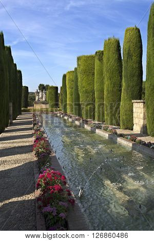 CORDOBA, SPAIN - September 10, 2015: The Promenade of the Kings with its water fountains in the gardens of the Alcazar on September 10, 2015 in Cordoba, Spain