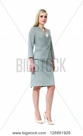 blond woman with straight hair style in office gray jacket skirt suit pair high heel shoes going full body length isolated on white