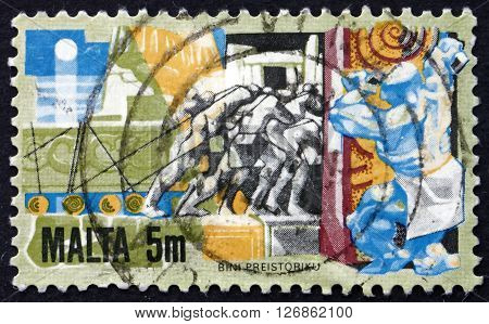 MALTA - CIRCA 1981: a stamp printed in Malta shows Man Hauling Building Stone circa 1981