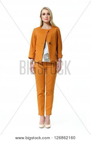 blond woman with straight hair style in office terracotta jacket trousers suit pair high heel shoes going full body length isolated on white