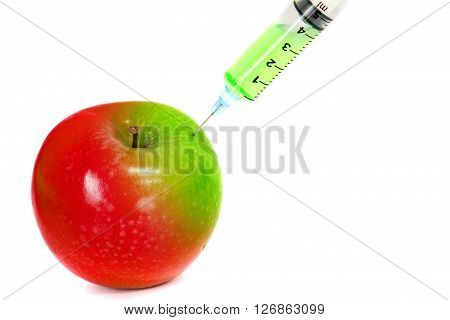 injection green into red fresh apple with syringe on white background for renew energy , therapy or refresh or boost up energy concept