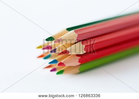 art, color, drawing, creativity and object concept - close up of crayons or color pencils