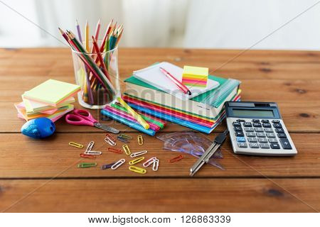 education, school supplies, art, creativity and object concept - close up of stationery on wooden table