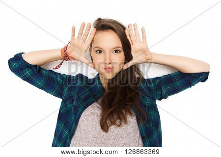 people and teens concept - happy smiling pretty teenage girl making face and having fun
