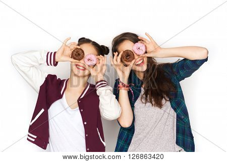 people, friends, teens and friendship concept - happy smiling pretty teenage girls with donuts making faces and having fun