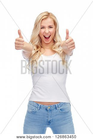 emotions, expressions, advertisement and people concept - happy smiling young woman or teenage girl in white t-shirt showing thumbs up with both hands