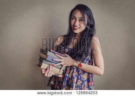 Young student carrying books